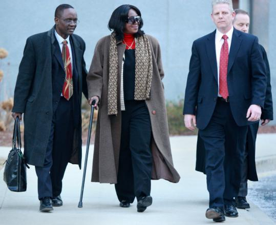 President Obama's aunt, Zeituni Onyango, was escorted from the JFK Federal Building to a waiting car after her hearing in February.