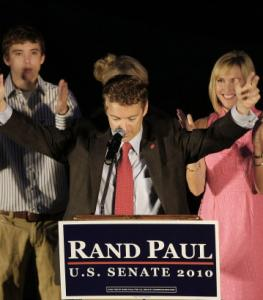 Republican US Senate candidate Rand Paul raised his arms to the cheers of supporters at his victory party in Bowling Green, Ky.