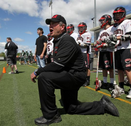North Andover coach Steve Connolly stayed on the sidelines while sons Ryan and Jim (behind) worked with the team at a game against Pentucket.