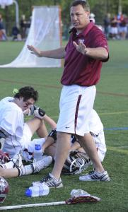 Weston lacrosse head coach Jim Wilcon talks to his players, including Will Harris, (left), during last week's tight battle with Concord-Carlisle.