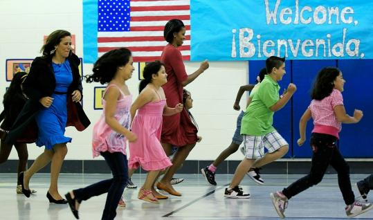 BACK TO SCHOOL — Michelle Obama and her Mexican counterpart, Margarita Zavala, hopped, skipped, and played with elementary school students yesterday at New Hampshire Estates Elementary School in Silver Spring, Md.