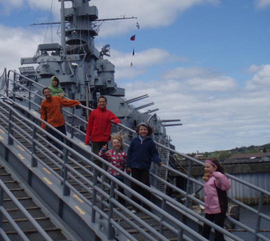 The Greenlee and Hallman kids at the USS Massachusetts at Battleship Cove.