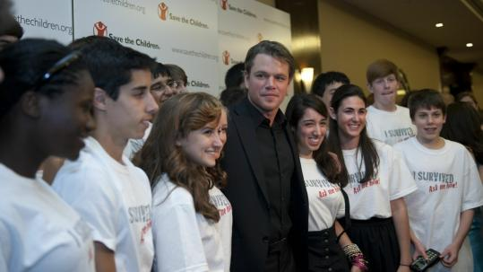 Matt Damon poses with members of the Teen Leadership Council at an award ceremony in Greenwich, Conn.