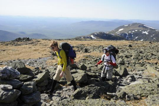 Mount Clay, the low peak with snow patches (right of center), and Mount Jefferson, the higher peak beyond it, were visible as backpackers Andrew Moody (left) and Matt