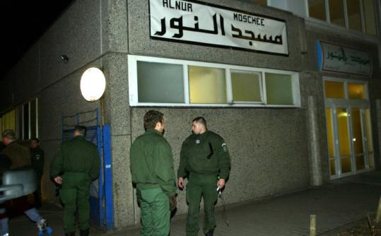 German police guard the entrance to a Berlin mosque in 2003 after the arrest of suspected terrorists who frequented it.
