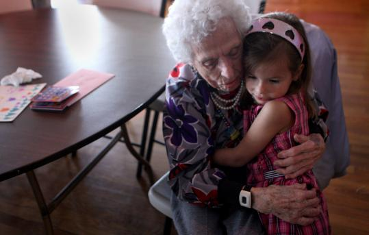 Milly England embraces her great-great-niece Reagan Bowden at her 110th birthday party earlier this month at the Eagles' Club in Lakeville.