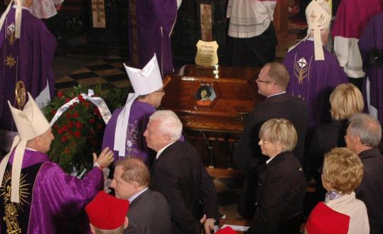 Priests and other attendees gathered beside the coffin holding the remains of 16th-century astronomer Nicolaus Copernicus yesterday in Frombork, northern Poland.