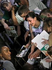 Glen Davis signed autographs on his way to the locker room after warming up before last night's playoff game.