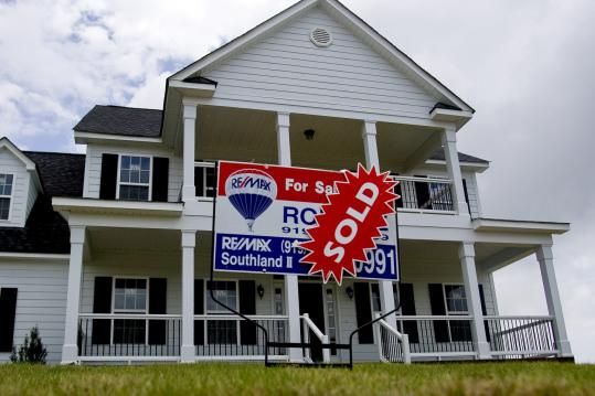 A 'Sold' sign at a home in Clayton, N.C. Sales of previously owned homes rose in April to the highest level in five months.