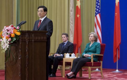 US Secretary of State Hillary Rodham Clinton and Treasury Secretary Timothy F. Geithner listened as President Hu Jintao said China will overhaul its currency at its own pace.