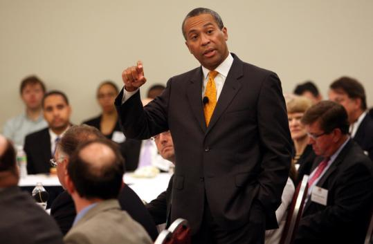 Governor Deval Patrick criticized Republican opposition to President Obama at a forum at Suffolk Law School's Rappaport Center yesterday.