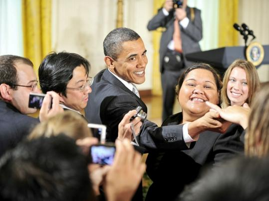 REACHING OUT - President Obama greeted people during a reception to celebrate Asian Pacific American Heritage Month in the East Room of the White House yesterday. Obama also sent legislation to Congress yesterday that would allow presidents to force lawmakers to vote on cutting earmarks and wasteful programs from spending bills.