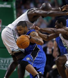 The Magic's Jameer Nelson ran into a crowd on this drive, getting swallowed up by Kevin Garnett and Tony Allen.