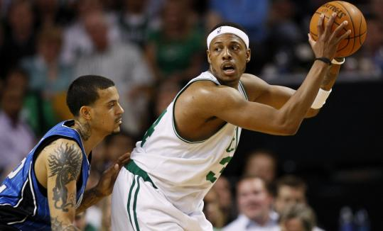 Orlando's Matt Barnes tried to keep Paul Pierce in check, but the Celtics star was looking for his offense in the first half of Game 4 at TD Garden.