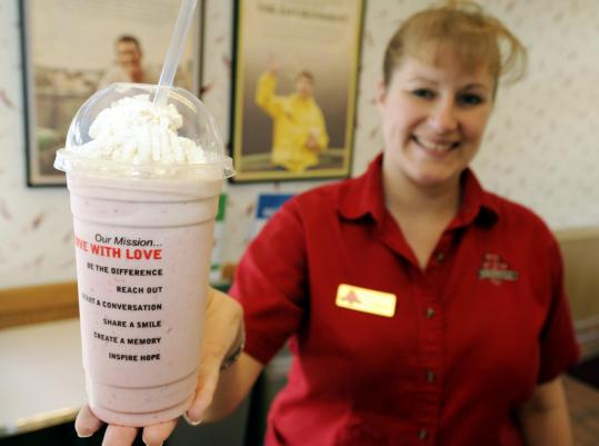 Laura Marshall, a general manager of a Burgerville franchise in Portland, Ore., with a strawberry shake. Burgerville's philosophy is fresh, local, and sustainable food.