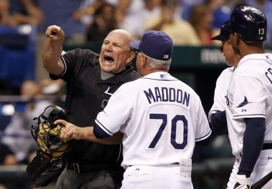 Rays manager Joe Maddon is, well, maddened by a strike call and gets the heave from plate umpire Bob Davidson.
