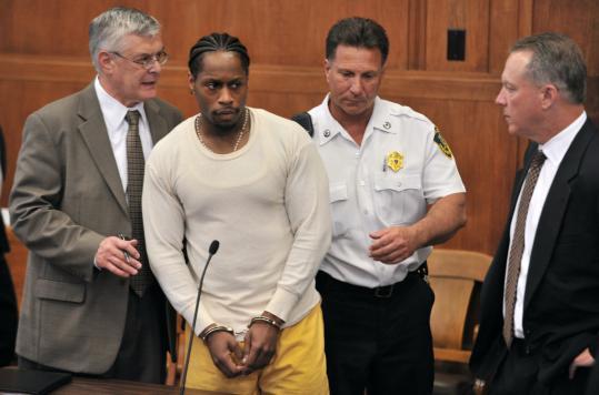 Above, defendant Paul Goode was led from a room at Suffolk Superior Court after a melee following sentencing.
