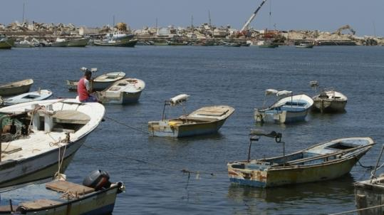 A Palestinian fisherman sat in Gaza City's Mediterranean port Sunday. A small flotilla will try to break the blockade of Gaza.