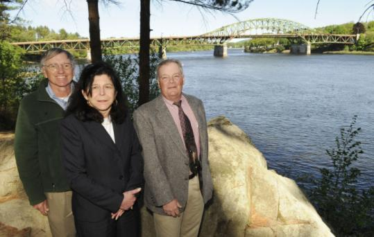 Salisbury Selectman Jerry Klima, Newburyport Mayor Donna Holaday, and Amesbury economic official Joseph Fahey (left to right) with Whittier Bridge in the background.