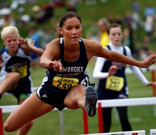 Pembroke High's Berkeley Hall competing in the girls' 100 meter hurdles last year. She will head to Dartmouth this fall and run track.