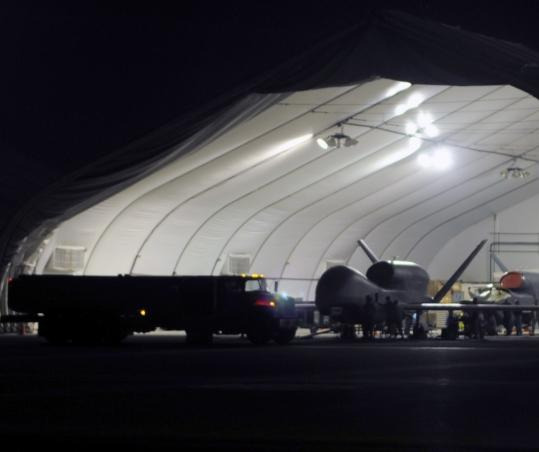 An RQ-4 Global Hawk drone aircraft is shown at an undisclosed base in January. The Air Force wants to cut by half the amount of petroleum-based jet fuel it uses in the United States by 2016.