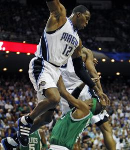 Rajon Rondo's drive to the basket was halted by the towering figure of Magic center Dwight Howard in the first half.