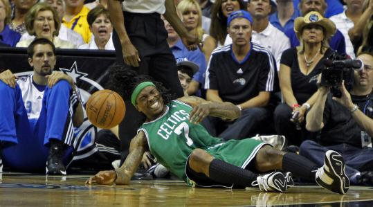Marquis Daniels was dazed and in pain after colliding with Magic center Marcin Gortat.