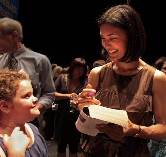 Actress Julia Jones greets Emily Snider, 12, of Newton and other fans at the Wheelock Family Theatre last night.