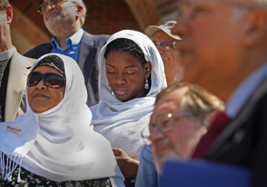 Zainab Elmi and Amenyohnah Bossman were among many gathered for the statement at the Roxbury mosque yesterday.