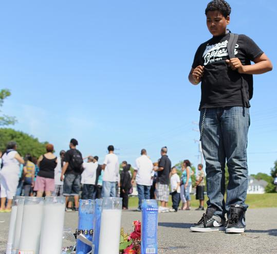 Edison Mercedes, 14, was at a makeshift memorial in Lawrence for his late classmate, Joshua Figueroa, who drowned.