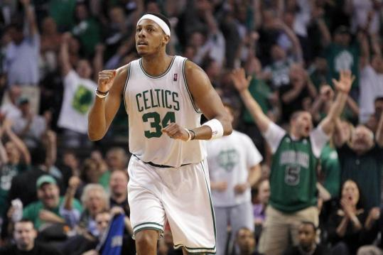 BRIAN SNYDER/REUTERS Captain Paul Pierce (31 points) celebrates after making a shot as he led the Celtics in last night&#8217;s win against Orlando.
