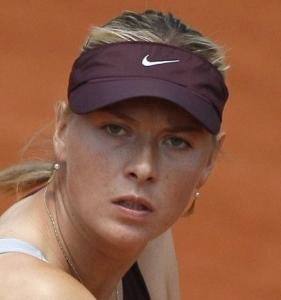 A straight-set win put the comebacking Maria Sharapova in line to face Justine Henin.