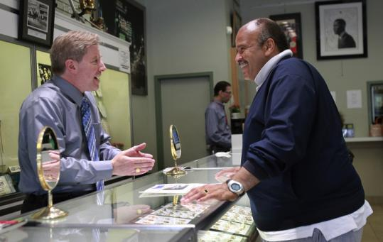 Mike Goldstein, owner of Empire Loan in the South End, with Derek Hector, whose brother pawned their father's Tuskegee Airmen ring five years ago before he died.