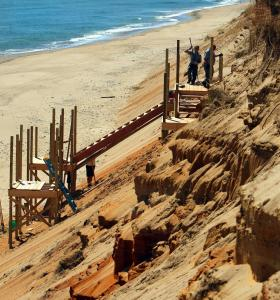 Workers installed a section of a new staircase being built at Marconi Beach in Wellfleet.