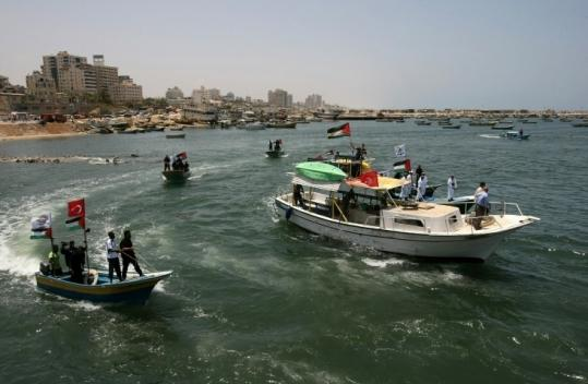 Hamas  police patrolled off the coast of Gaza City, awaiting the aid flotilla  headed there in defiance of an Israeli embargo.