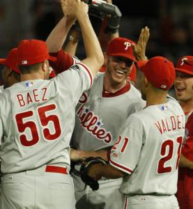 Phillies teammates rush to congratulate Roy Halladay after he added a perfect game to an already impressive season.