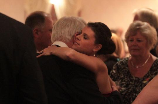 Megan Van De Giesen, the widow of Marine Captain Kyle Van De Giesen, hugged her cousin, Kevin Calden.