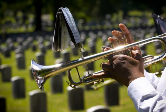 Charles Lewis, a member of the Frank Zarba Band, played yesterday at Mount Hope Cemetery in Mattapan. The observance featured speakers from the Gold Star Mothers, the state Department of Veterans Services, and the Boston City Council.