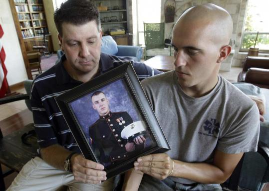 In Kerrville, Texas, on Saturday, Jonathan (left) and Jesse Leicht spoke about their brother, Marine Corporal Jacob Leicht, the 1,000th service member killed in Afghanistan.