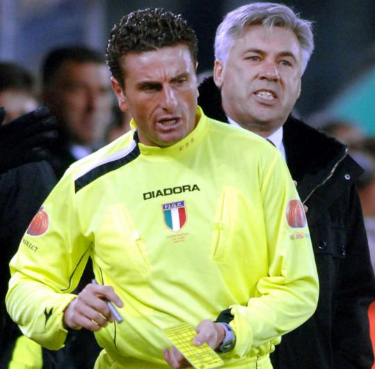 In 2006, after it was revealed that Italian officials arranged for referees favorable to certain teams to officiate key domestic matches, Massimo de Santis (left) was removed from Cup duty.