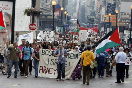 More than 250 people marched from Park Street Station to Faneuil Hall to protest the Israeli raid on a flotilla of aid ships bound for the Gaza Strip.