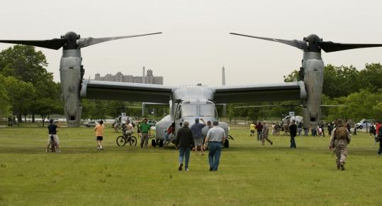 The Osprey aircraft's twin rotors, on display last week in New York, stirred up wind yesterday that downed branches and swirled debris at a States Island demonstration, injuring 10.