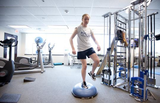 Amanda Keane, 17, of Wilmington, worked on balancing during therapy at Proex Physical Therapy in Woburn last week.