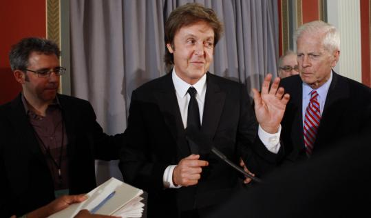 "HONOR FOR McCARTNEY — The former Beatle, shown yesterday in Washington, will receive the Library of Congress Gershwin Prize for Popular Song today and perform at the White House. He has ""made an impact far beyond music through his humanitarianism and activism,'' said James Billington, librarian of Congress."