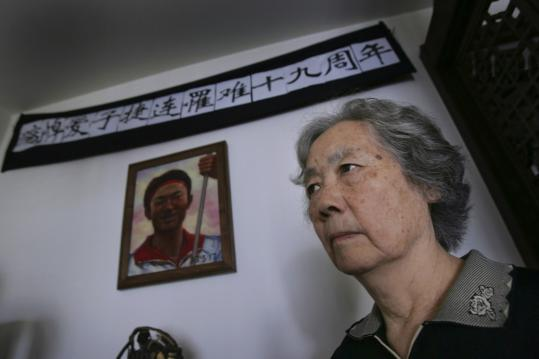 Ding Zilin, cofounder of the Tiananmen Mothers, stood before a photo of her son, Jiang Jielian, who died in the prodemocracy crackdown in Tiananmen Square 21 years ago tomorrow.