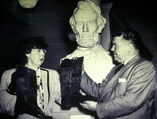 Ruth Hatch of Lynn donated Lincoln's boots to the nation, handing them over to Irving C. Root, head of the National Park Service Washington region, at Ford's Theatre on April 30, 1947.