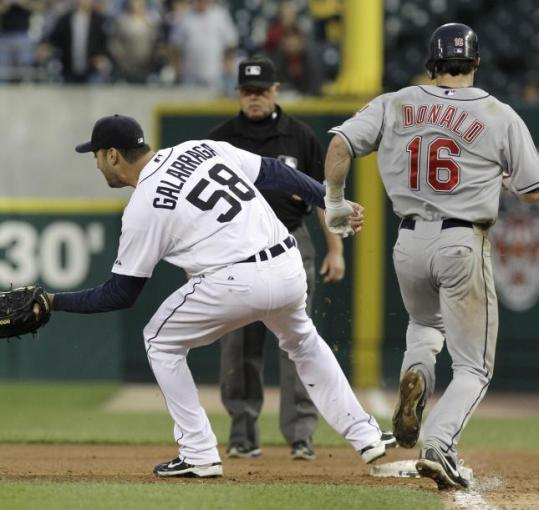 Tigers pitcher Armando Galarraga caught the ball and tagged first base before Jason Donald touched the bag but umpire Jim Joyce called Donald safe.