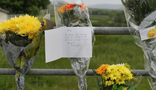 Floral tributes were left near where Derrick Bird reportedly killed Garry Purdham as he trimmed hedges in Gosforth, England.