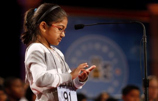"Vanya Shivashankar, 8, of Olathe, Kan., spelled ""euthanasia'' yesterday at the Scripps National Spelling Bee in Washington."