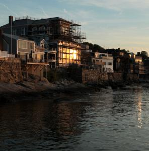 The setting sun bounces off the 330-seat Shalin Liu Performance Center, the new home of Rockport Music.